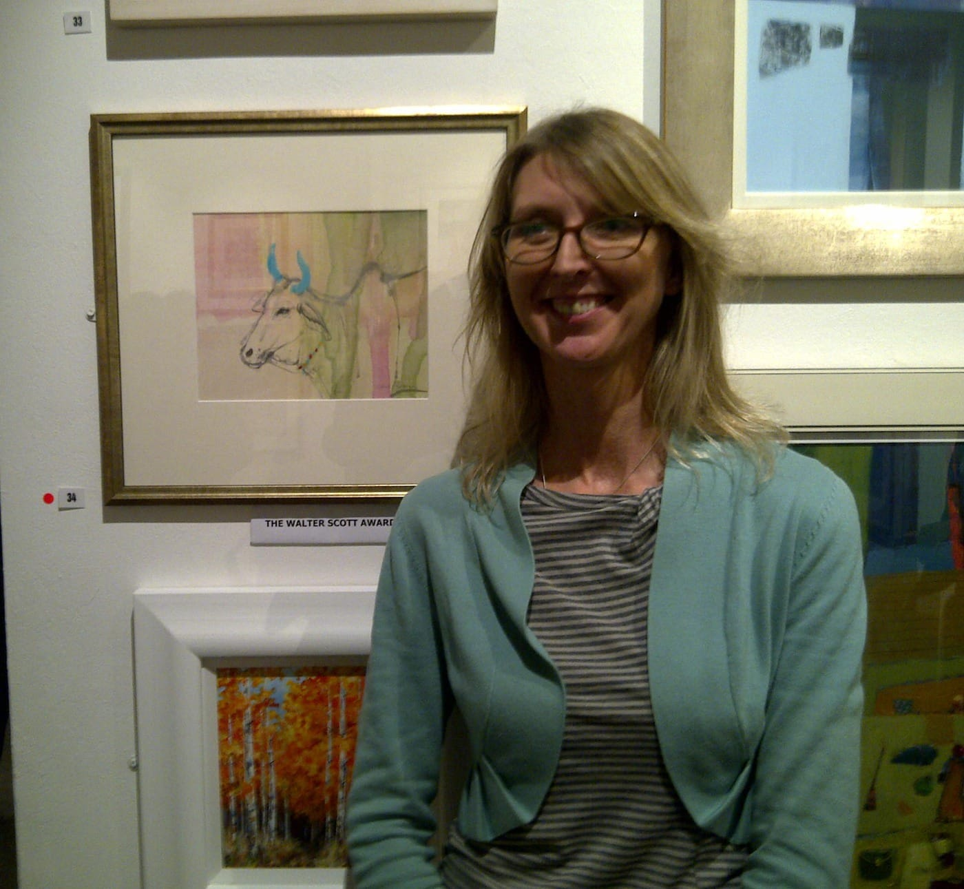 Claire Harkess with award winning painting Sacred Cow, India